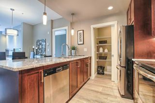 """Photo 3: 411 2242 WHATCOM Road in Abbotsford: Abbotsford East Condo for sale in """"WATERLEAF"""" : MLS®# R2016887"""