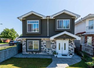 Photo 1: 496 E 59TH Avenue in Vancouver: South Vancouver House for sale (Vancouver East)  : MLS®# R2353574