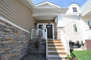 Photo 2: 4344 VETERANS Way in Edmonton: Zone 27 House Half Duplex for sale : MLS®# E4158621