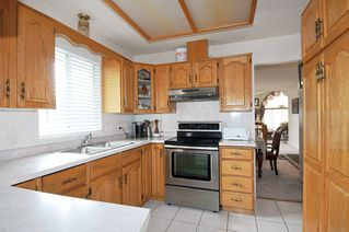 Photo 2: 3638 SEFTON Street in Port Coquitlam: Glenwood PQ House for sale : MLS®# R2374589