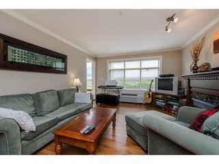 """Photo 2: 105 45753 STEVENSON Road in Sardis: Sardis East Vedder Rd Condo for sale in """"Park Place II"""" : MLS®# R2375433"""