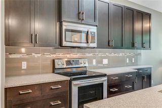 Photo 7: 71 CORTINA Villa SW in Calgary: Springbank Hill Semi Detached for sale : MLS®# C4253496