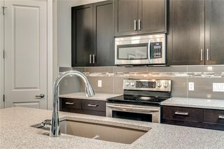 Photo 9: 71 CORTINA Villa SW in Calgary: Springbank Hill Semi Detached for sale : MLS®# C4253496