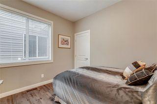 Photo 18: 71 CORTINA Villa SW in Calgary: Springbank Hill Semi Detached for sale : MLS®# C4253496