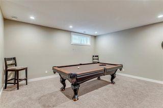Photo 23: 71 CORTINA Villa SW in Calgary: Springbank Hill Semi Detached for sale : MLS®# C4253496