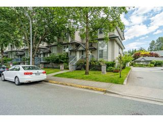 "Photo 1: 50 19034 MCMYN Road in Pitt Meadows: Mid Meadows Townhouse for sale in ""MEADOW VALE"" : MLS®# R2466839"