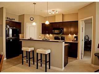 Photo 3: 211 1 Crystal Green Lane: Okotoks Condo for sale : MLS®# C3612012