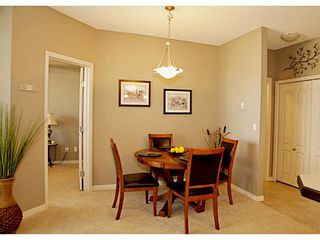 Photo 8: 211 1 Crystal Green Lane: Okotoks Condo for sale : MLS®# C3612012