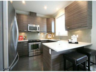 "Photo 4: 15 14177 103 Avenue in Surrey: Whalley Townhouse for sale in ""THE MAPLE"" (North Surrey)  : MLS®# F1425573"