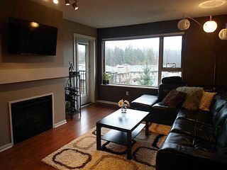 "Photo 1: 414 200 KLAHANIE Drive in Port Moody: Port Moody Centre Condo for sale in ""SALAL"" : MLS®# V1097743"
