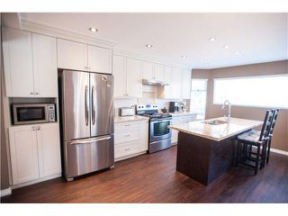 """Photo 2: 6 1195 FALCON Drive in Coquitlam: Eagle Ridge CQ Townhouse for sale in """"THE COURTYARDS"""" : MLS®# V1108276"""