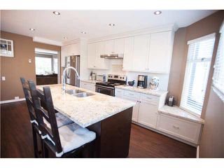 "Photo 1: 6 1195 FALCON Drive in Coquitlam: Eagle Ridge CQ Townhouse for sale in ""THE COURTYARDS"" : MLS®# V1108276"