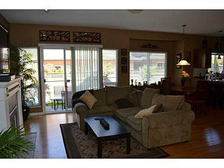"""Photo 2: 18 3363 ROSEMARY HEIGHTS Crescent in Surrey: Morgan Creek Townhouse for sale in """"ROCKWELL"""" (South Surrey White Rock)  : MLS®# F1438051"""