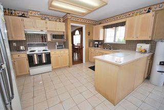 Photo 6: 7722 Berkley Street in Burnaby Lake Area: Home for sale