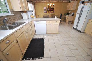Photo 7: 7722 Berkley Street in Burnaby Lake Area: Home for sale