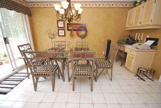 Photo 9: 7722 Berkley Street in Burnaby Lake Area: Home for sale