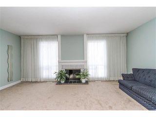 Photo 2: 639 CEDARILLE Way SW in Calgary: Cedarbrae House for sale : MLS®# C4096663