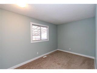 Photo 9: 639 CEDARILLE Way SW in Calgary: Cedarbrae House for sale : MLS®# C4096663