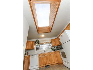 Photo 12: 639 CEDARILLE Way SW in Calgary: Cedarbrae House for sale : MLS®# C4096663