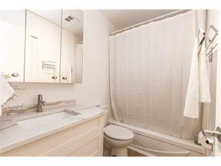 Photo 8: 639 CEDARILLE Way SW in Calgary: Cedarbrae House for sale : MLS®# C4096663