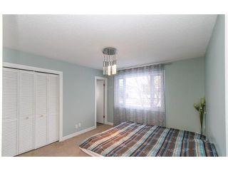 Photo 5: 639 CEDARILLE Way SW in Calgary: Cedarbrae House for sale : MLS®# C4096663