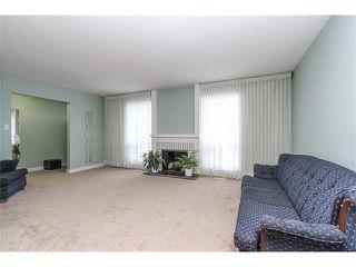 Photo 4: 639 CEDARILLE Way SW in Calgary: Cedarbrae House for sale : MLS®# C4096663