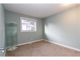 Photo 7: 639 CEDARILLE Way SW in Calgary: Cedarbrae House for sale : MLS®# C4096663