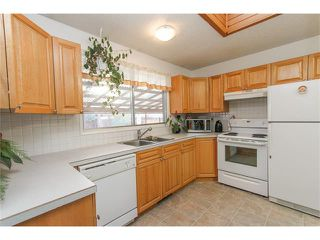 Photo 11: 639 CEDARILLE Way SW in Calgary: Cedarbrae House for sale : MLS®# C4096663