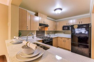 "Photo 2: 211 15210 GUILDFORD Drive in Surrey: Guildford Condo for sale in ""Boulevard Club"" (North Surrey)  : MLS®# R2321134"