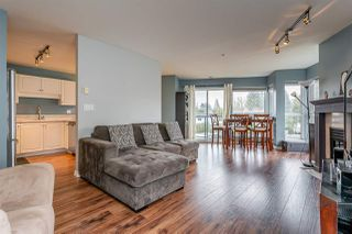 "Photo 1: 204 20277 53 Avenue in Langley: Langley City Condo for sale in ""The Metro II"" : MLS®# R2347214"