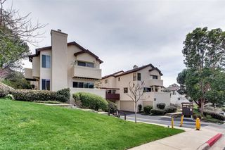 Photo 1: LINDA VISTA Townhome for sale : 1 bedrooms : 6665 Canyon Rim Row #223 in San Diego
