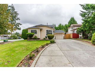 Photo 1: 6186 130 Street in Surrey: Panorama Ridge House for sale : MLS®# R2508593