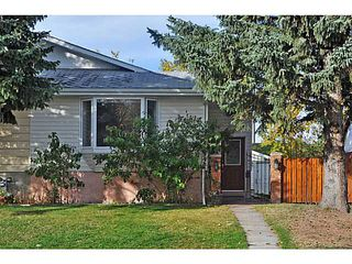 Photo 1: 11736 CANFIELD Road SW in Calgary: Canyon Meadows Half Duplex for sale : MLS®# C3639691