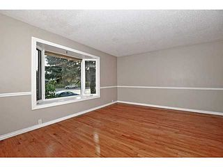 Photo 3: 11736 CANFIELD Road SW in Calgary: Canyon Meadows Half Duplex for sale : MLS®# C3639691
