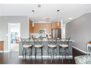 """Photo 8: 306 400 CAPILANO Road in Port Moody: Port Moody Centre Condo for sale in """"ARIA II AT SUTTERBROOK"""" : MLS®# V1126880"""