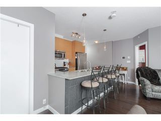 """Photo 7: 306 400 CAPILANO Road in Port Moody: Port Moody Centre Condo for sale in """"ARIA II AT SUTTERBROOK"""" : MLS®# V1126880"""