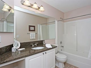 Photo 14: 322 MEADOWBROOK Bay SE: Airdrie House for sale : MLS®# C4024386