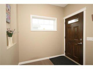 Photo 2: 140 PAINT HORSE Drive: Cochrane House for sale : MLS®# C4027204