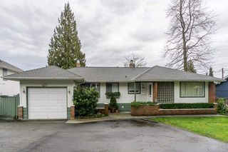 Photo 1: 880 FAIRWAY Drive in North Vancouver: Dollarton House for sale : MLS®# R2035154