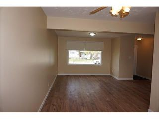 Photo 2: 2420 47 Street SE in Calgary: Forest Lawn House for sale : MLS®# C4114027