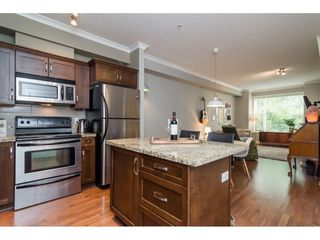 "Photo 13: 205 20286 53A Avenue in Langley: Langley City Condo for sale in ""CASA VERONA"" : MLS®# R2193599"