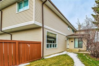 Photo 1: 60 1155 FALCONRIDGE Drive NE in Calgary: Falconridge Row/Townhouse for sale : MLS®# C4242650