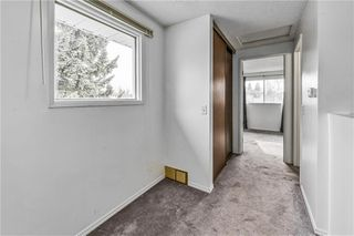 Photo 10: 60 1155 FALCONRIDGE Drive NE in Calgary: Falconridge Row/Townhouse for sale : MLS®# C4242650