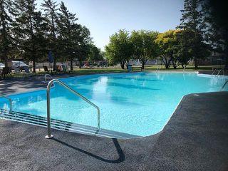 Photo 16: 130 MAPLE Street in Gimli: Aspen Park Condominium for sale (R26)  : MLS®# 202013027