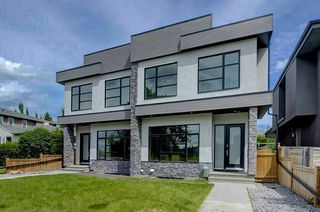 Main Photo: 720 37 Street NW in Calgary: Parkdale Semi Detached for sale : MLS®# A1015335