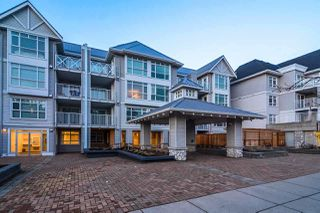 """Photo 1: 215 3122 ST JOHNS Street in Port Moody: Port Moody Centre Condo for sale in """"Sonrisa"""" : MLS®# R2146723"""