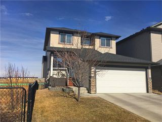 Main Photo: 664 LUXSTONE Landing SW: Airdrie House for sale : MLS®# C4106944