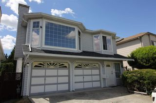 Photo 1: 3747 ULSTER Street in Port Coquitlam: Oxford Heights House for sale : MLS®# R2273900