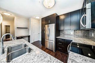 "Photo 1: 201 6480 194 Street in Surrey: Clayton Condo for sale in ""WATERSTONE - ESPLANADE"" (Cloverdale)  : MLS®# R2379368"