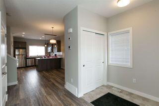 Photo 10: 219 GRIESBACH Road in Edmonton: Zone 27 House Half Duplex for sale : MLS®# E4192905